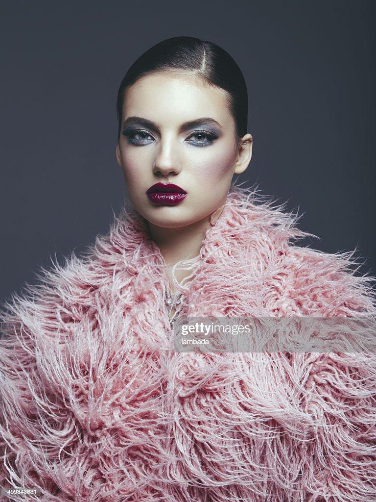 Fashion model in fur coat : Stock Photo