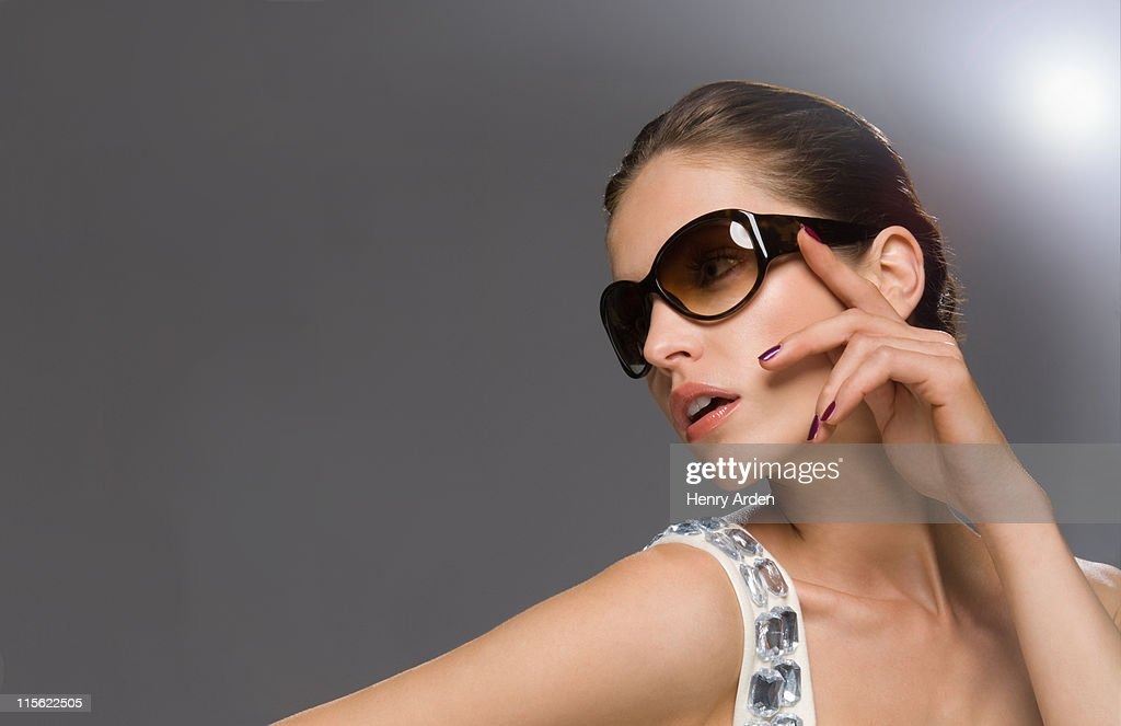 fashion model in glasses looking off camera : Stock Photo