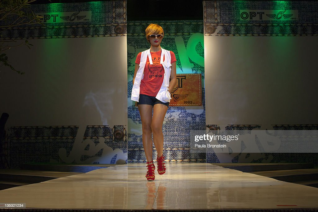 Fashion model Jessica, 21, strolls down the stage during a fashion show featuring OPT jeans December 8, 2011 in Yangon, Myanmar. The pace of change in Myanmar brought U.S Secretary of State Hillary Clinton to the country where she discussed further paths to reform and crucial talks with both Aung San Suu Kyi and the highest levels of the Burmese government. For many years Myanmar has suffered from economic stagnation, political repression and international isolation. In March the army handed power to a civilian government after almost five decades of the military regime's strong arm rule. The handover took place after a controlled election under a new constitution that preserved much of the military clout. Internet has been loosened up as previously inaccessible foreign news and opposition websites have been unblocked.