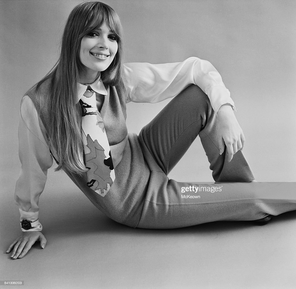 Fashion model Melissa Condon shows a tie satin shirt camel pullover and camel trousers all by Jaeger 17th March 1967