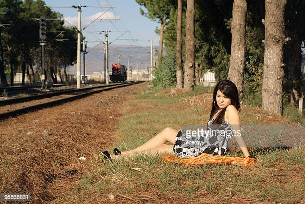 fashion model next to the railroad