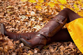 Fashion Model On  Colorful Autumn Leaves