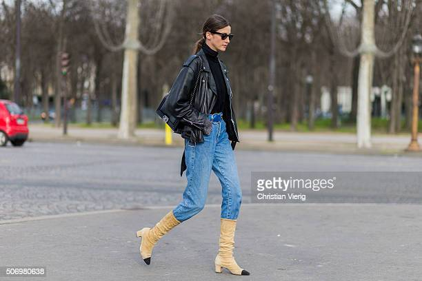 A fashion model outside Chanel during the Paris Fashion Week Haute Couture Spring/Summer 2016 on January 26 2016 in Paris France