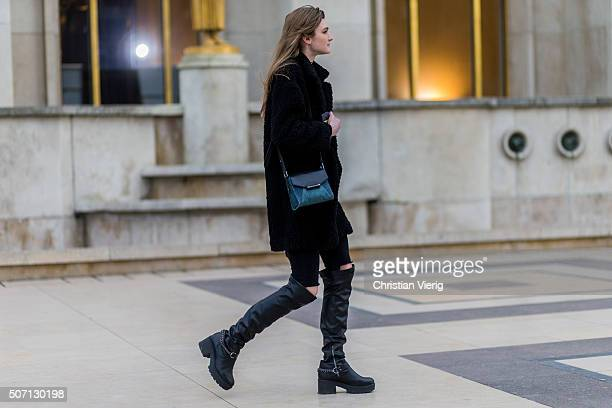 A fashion model outside Elie Saab during the Paris Fashion Week Haute Couture Spring/Summer 2016 on January 27 2016 in Paris France