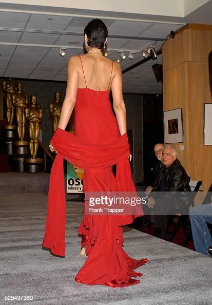 Fashion model Paula wears David Rodriquez red tiered slip gown with Martin Katz diamond rope chain 141 1 ct diamonds 3 row diamond drop earrings 39...