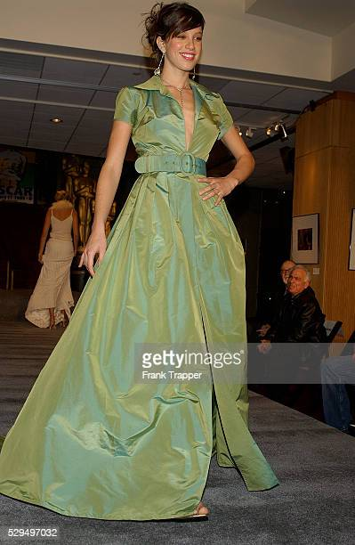 Fashion model Paz wears a Kevan hall green taffeta dress and beaded pant with Chopard you and me emerald and diamond drop earrings at the 77th Annual...
