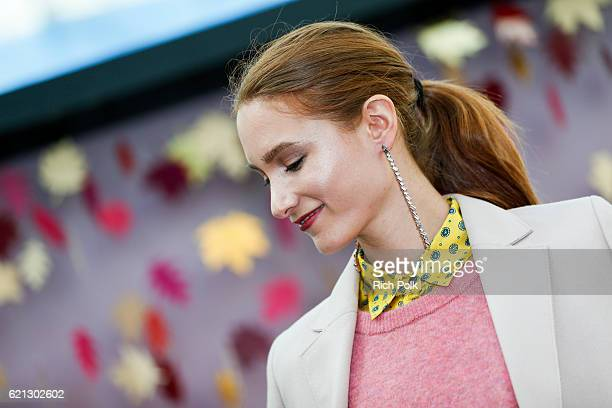 A fashion model poses on stage at the Westfield Topanga x Ellecom Fall Trend Report at Westfield Topanga on November 5 2016 in Canoga Park California