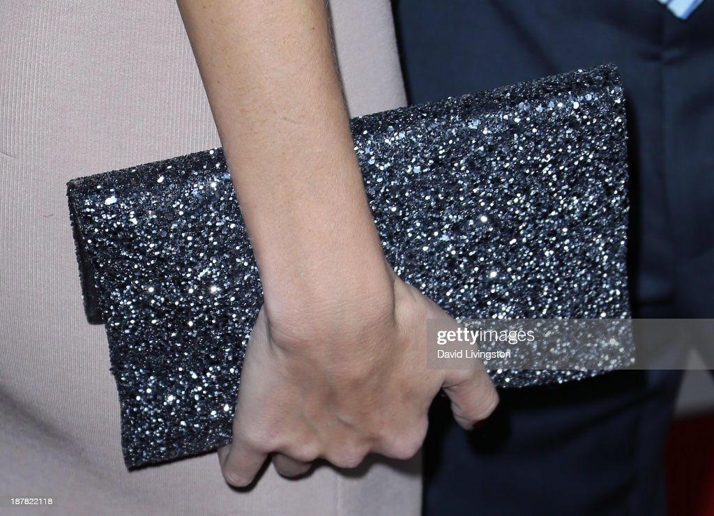 Fashion model Rhea Durham (purse detail) attends the AFI FEST 2013 presented by Audi premiere of 'Lone Survivor' at the TCL Chinese Theatre on November 12, 2013 in Hollywood, California.