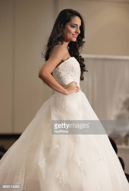 Fashion model showcases an elegant wedding gown during a bridal fashion show held in Mississauga Ontario Canada