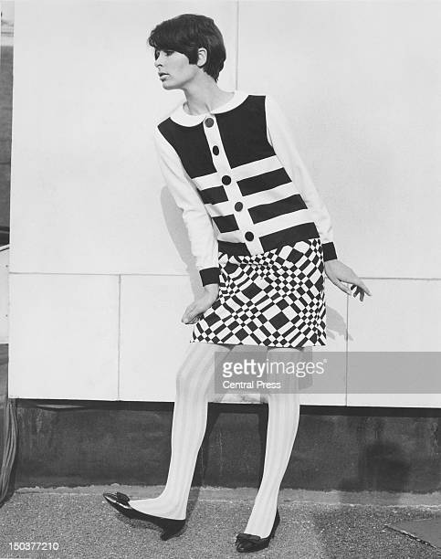 Fashion model Virginia Wonnacott wears a black and white cotton dress in checks and stripes one of the garments on display during the 14th London...