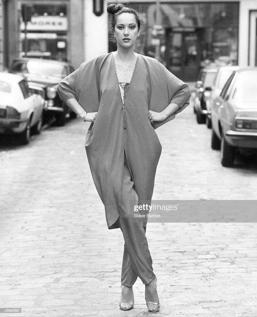 A fashion model wearing a Crepe de Chine tunic over a shimmering sequin boob tube by Nina Ricci in London.