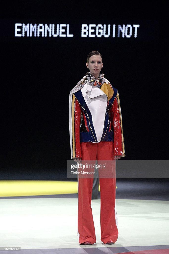 A fashion model wearing a design from Emmanuel Beguinot walks the catwalk of The Antwerp Fashion Academy show on June 12, 2014 in Antwerpen, Belgium.