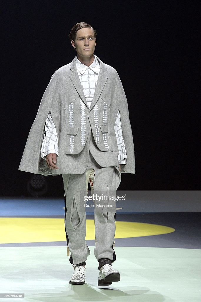 A fashion model wearing a design from Jennifer Dols walks the catwalk of The Antwerp Fashion Academy show on June 12, 2014 in Antwerpen, Belgium.