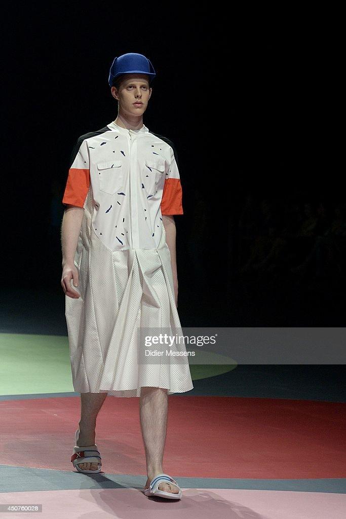 A fashion model wearing a design from Ken Thaodee walks the catwalk of The Antwerp Fashion Academy show on June 12, 2014 in Antwerpen, Belgium.
