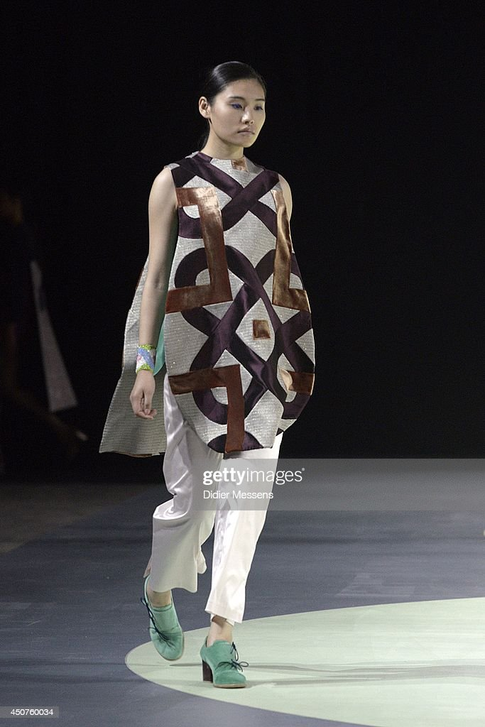 A fashion model wearing a design from Madeleine Coisne walks the catwalk of The Antwerp Fashion Academy show on June 12, 2014 in Antwerpen, Belgium.