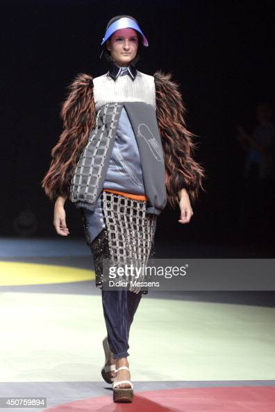 A fashion model wearing a design from Ola Kawalko walks the catwalk of The Antwerp Fashion Academy show on June 12 2014 in Antwerpen Belgium