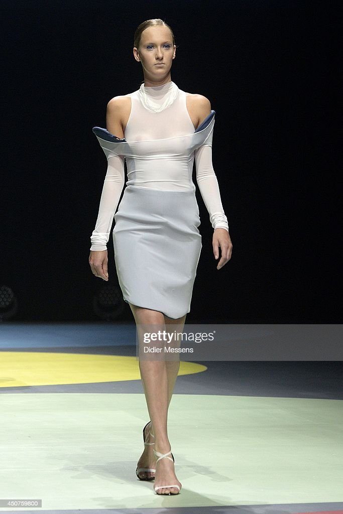A fashion model wearing a design from Raphaelle Lenseigne walks the catwalk of The Antwerp Fashion Academy show on June 12, 2014 in Antwerpen, Belgium.