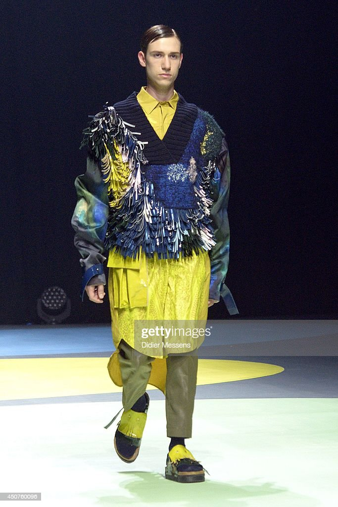 A fashion model wearing a design from Timo Zundorf walks the catwalk of The Antwerp Fashion Academy show on June 12, 2014 in Antwerpen, Belgium.