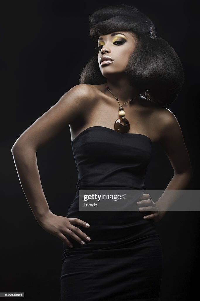 fashion model wearing black dress stock photo getty images