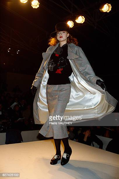 A fashion model wears a lined coat and matching skirt with a sweater by French fashion designer Emmanuelle Khanh at her autumnwinter 19871988 fashion...