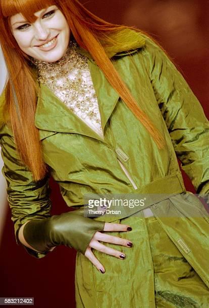 A fashion model wears a Lolita Lempicka ReadyToWear women's fashion ensemble during a FallWinter 20002001 fashion show The outfit includes a long...