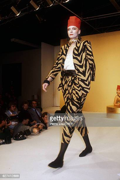 A fashion model wears a patterned readytowear jacket and pants suit by French fashion designer Emmanuelle Khanh She modeled the suit during the...