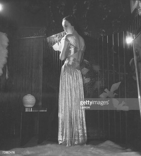 A fashion model wears an evening gown designed by French fashion designer Jeanne Lanvin Paris February 1935