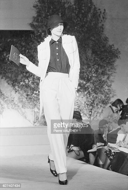 A fashion model wears readytowear women's fashions from French fashion house Emmanuelle Khanh during a 1976 SpringSummer fashion show in Paris Her...