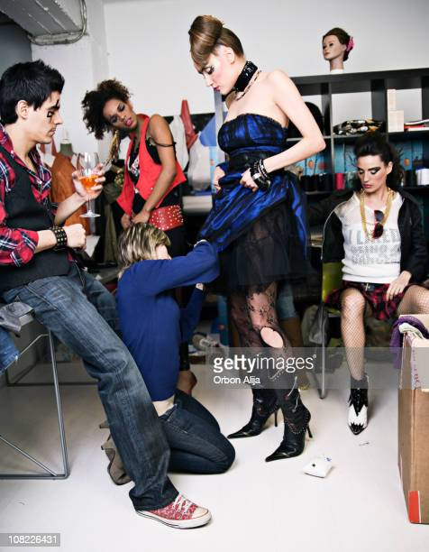 Fashion Models Changing Backstage and Man Drinking