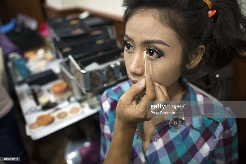 Fashion models get their make up done backstage for a fashion show featuring OPT jeans December 8, 2011 in Yangon, Myanmar. The pace of change in Myanmar brought U.S Secretary of State Hillary Clinton to the country where she discussed further paths to reform and crucial talks with both Aung San Suu Kyi and the highest levels of the Burmese government. For many years Myanmar has suffered from economic stagnation, political repression and international isolation. In March the army handed power to a civilian government after almost five decades of the military regime's strong arm rule. The handover took place after a controlled election under a new constitution that preserved much of the military clout. Internet has been loosened up as previously inaccessible foreign news and opposition websites have been unblocked.