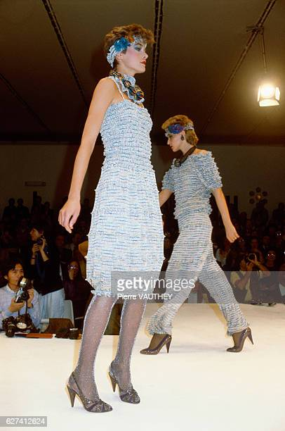 Fashion models wear readytowear women's fashions from Italian fashion house Missoni during a 19821983 FallWinter fashion show in Milan The model in...