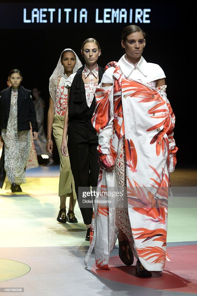 Fashion models wearing a design from Laetitia Lemaire walks the catwalk of The Antwerp Fashion Academy show on June 12, 2014 in Antwerpen, Belgium.