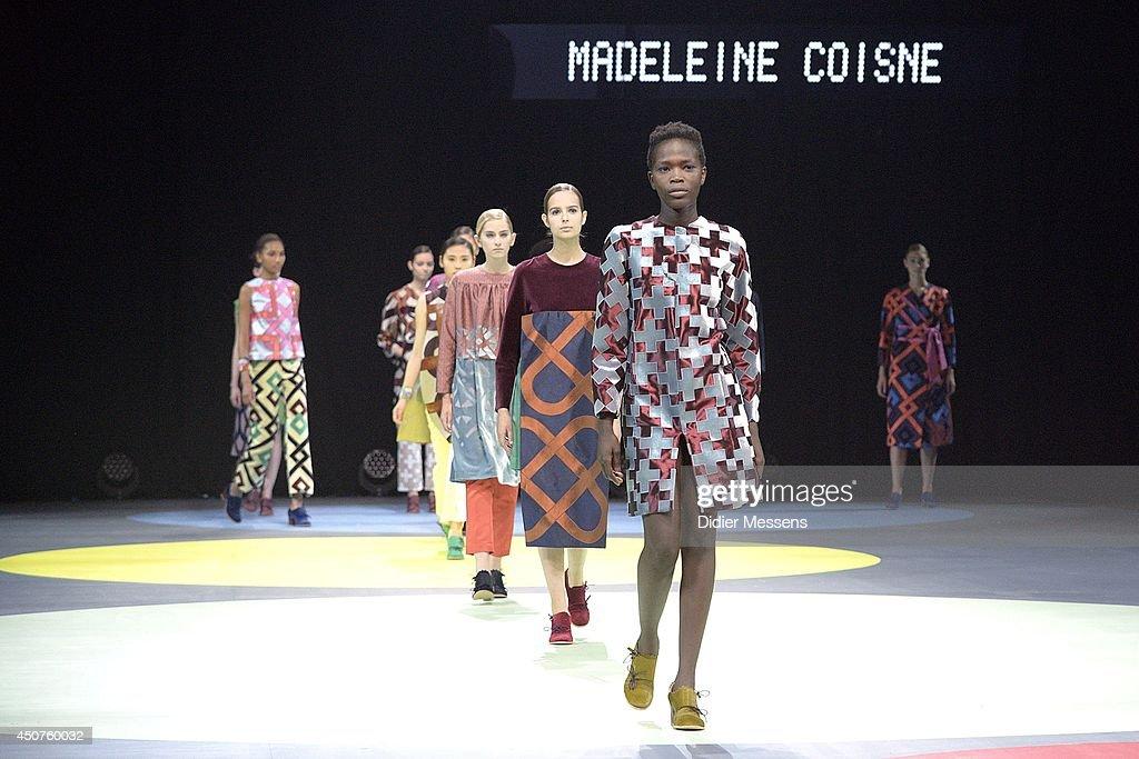 Fashion models wearing a design from Madeleine Coisne walks the catwalk of The Antwerp Fashion Academy show on June 12, 2014 in Antwerpen, Belgium.