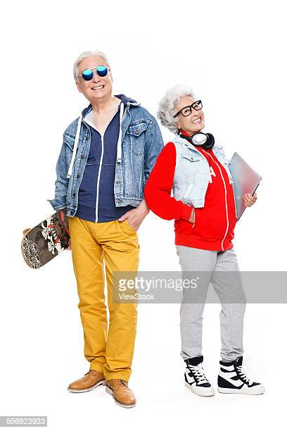 Fashion of older couples with a skateboard and laptops