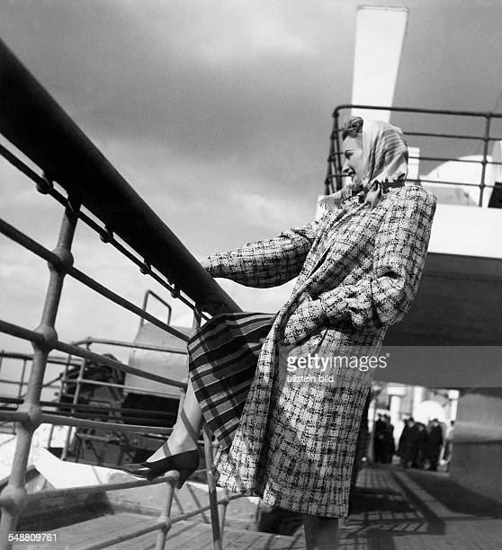 Fashion on deck of the 'Bremen Europe' woman in a checked coat 1939 Photographer Karl Ludwig Haenchen Published by 'Die Dame' 11/1939 Vintage...