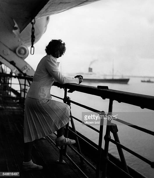 Fashion on deck of the 'Bremen Europe' woman in a white suit pleated wool skirt and jacket 1939 Photographer Karl Ludwig Haenchen Published by 'Die...