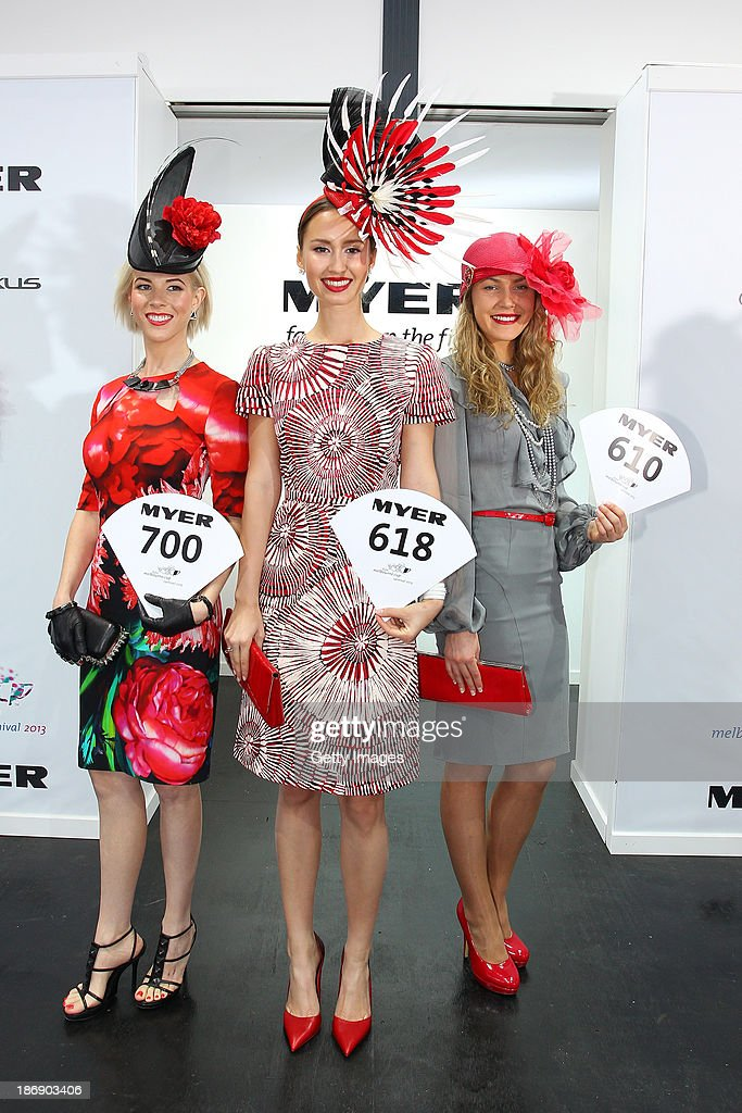 Fashion on the Field women's raceweary first runner up, Christine Spielmann, winner, Chloe Moo and second runner up, Brooke Walter pose for a photo during Melbourne Cup Day at Flemington Racecourse on November 5, 2013 in Melbourne, Australia.