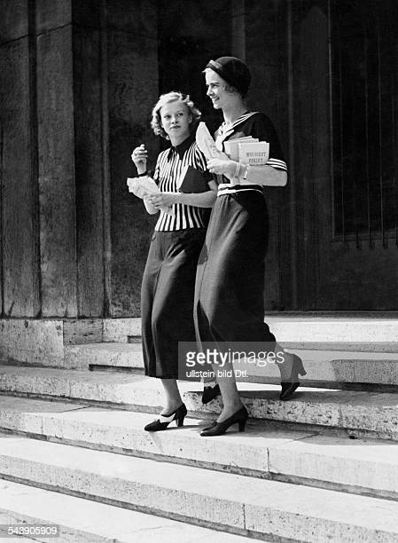 on the left side a woman in a striped short pullover with zipper and skirt on the right a woman in a sailor dress 1936 Photographer Hedda Walther...