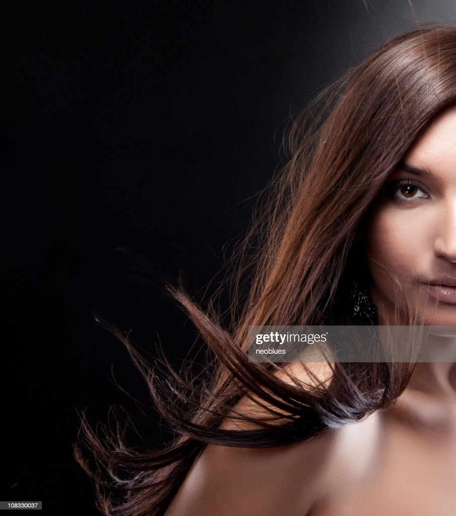 Fashion photo of beautiful woman with magnificent hair : Stock Photo