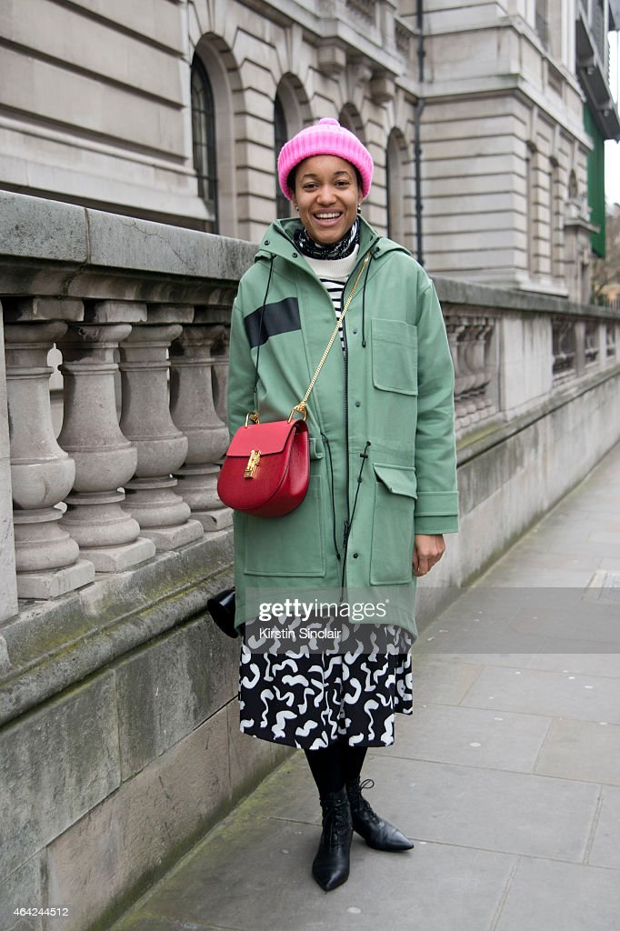 Fashion Photographer and Blogger Tamu McPherson wears a Etre Cecile jacket, Cos sweatshirt, Chloe bag, Edit dress and YSL boots on day 3 of London Collections: Women on February 22, 2015 in London, England.