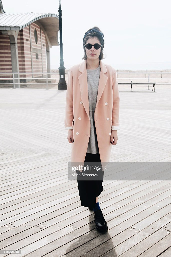 Fashion photographer and creative director Itziar Calle wearing minimalistic pea coat, long grey sweater, black skirt by Pinko and black H&M shoes seen on March 21, 2016 in New York City.