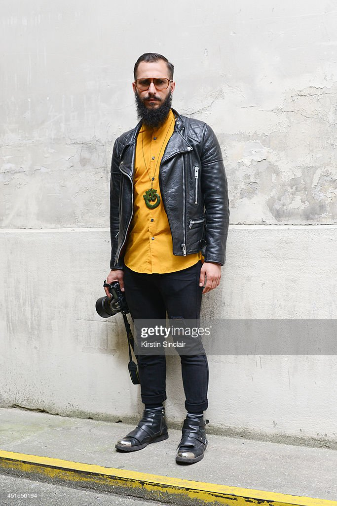 Fashion photographer Antonio Giacometti wearing H and M shirt and jeans, vintage jacket,Costume Nationale boots and vintage Lozza sunglasses on day 1 of Paris Collections: Men on June 25, 2014 in Paris, France.