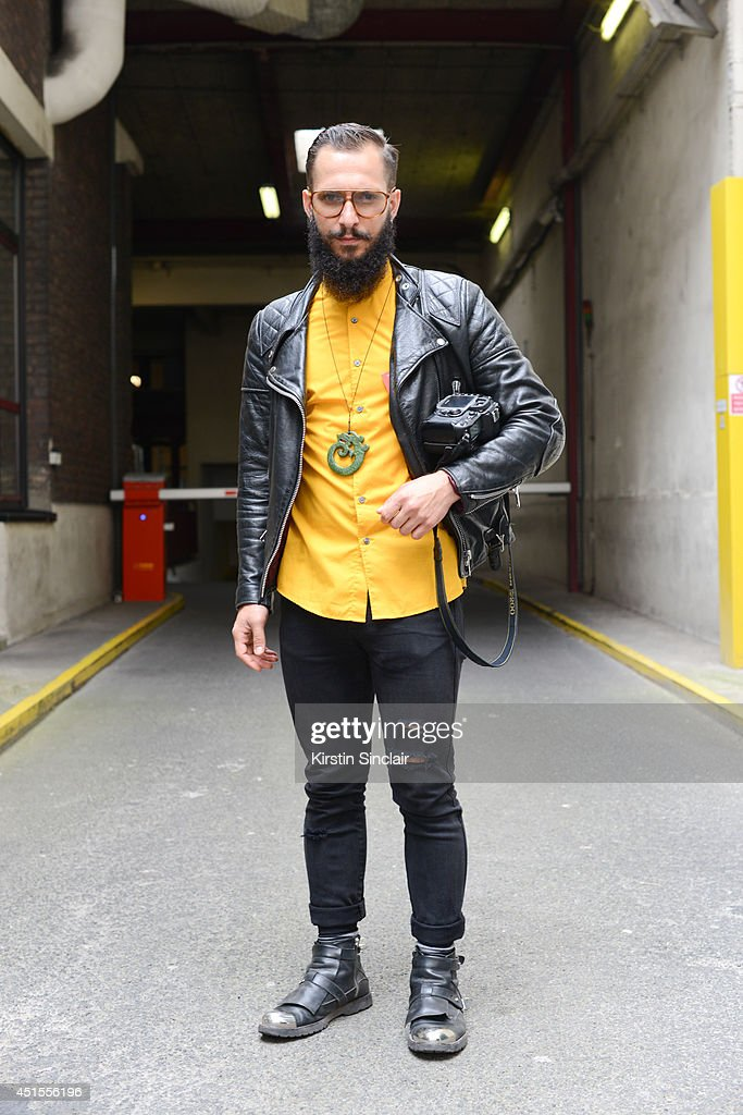Fashion photographer Antonio Giacometti wearing H and M shirt and jeans, Costume Nationale boots, vintage jacket and vintage Lozza sunglasses on day 1 of Paris Collections: Men on June 25, 2014 in Paris, France.