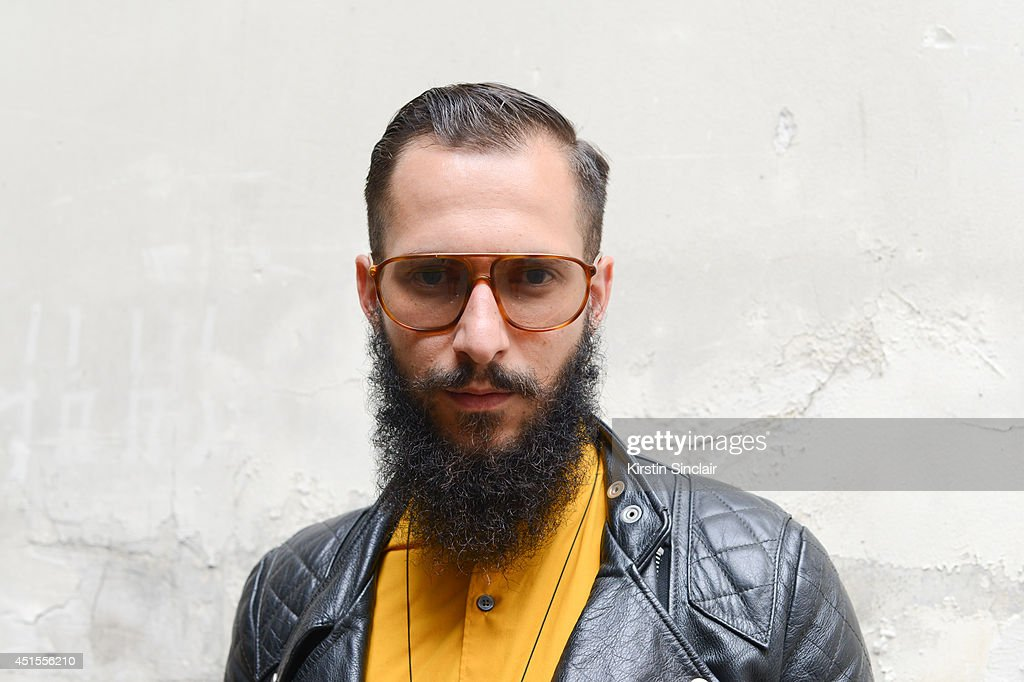 Fashion photographer Antonio Giacometti wearing H and M shirt, vintage jacket and vintage Lozza sunglasses on day 1 of Paris Collections: Men on June 25, 2014 in Paris, France.