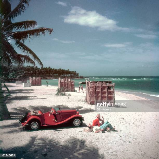 1950 Fashion photographer John Rawlings on the beach at Montego Bay Jamaica