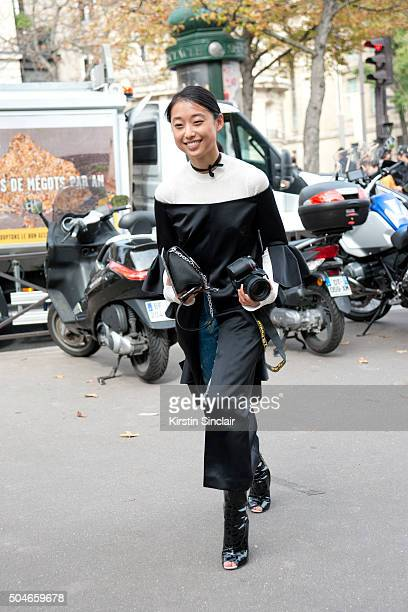Fashion Photographer Margaret Zhang wears Givenchy shoes Louis Vuitton bag Ellery jacket and 3 x 1 jeans on day 9 during Paris Fashion Week...