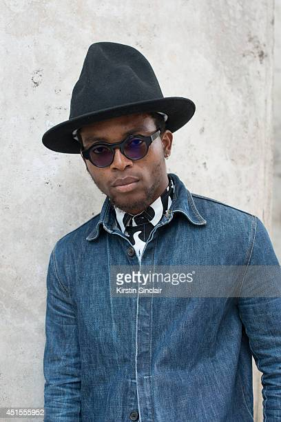 Fashion photographer Nabile Quenum wearing a Dior vest KTZ shirt and a Vivienne Westwood hat on day 1 of Paris Collections Men on June 25 2014 in...