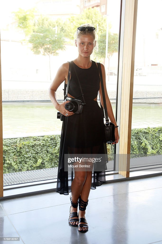 Fashion photographer Yulia Podol'skaya from Ukraine wears: a H&M dress, a Mango glasses and vintage shoes at the 080 Barcelona Fashion Week Spring/Summer 2014 on July 11, 2013 in Barcelona, Spain.