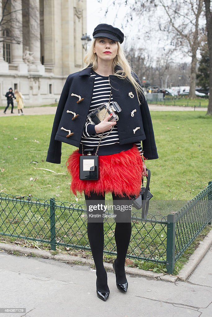 Fashion photographer Zhanna Romashka wears a Chanel bag day 2 of Paris Haute Couture Fashion Week Spring/Summer 2014 on January 21 2014 in Paris...