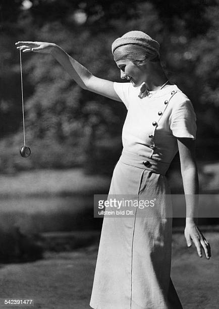 Fashion pictures A young woman in a light linen dress plays yoyo 1932 Photographer Fotografisches Atelier Ullstein Published by 'Berliner Illustrirte...